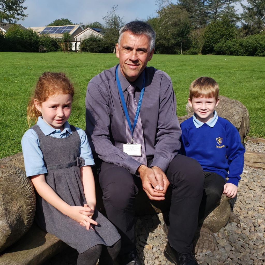 Mr Phelps with pupils